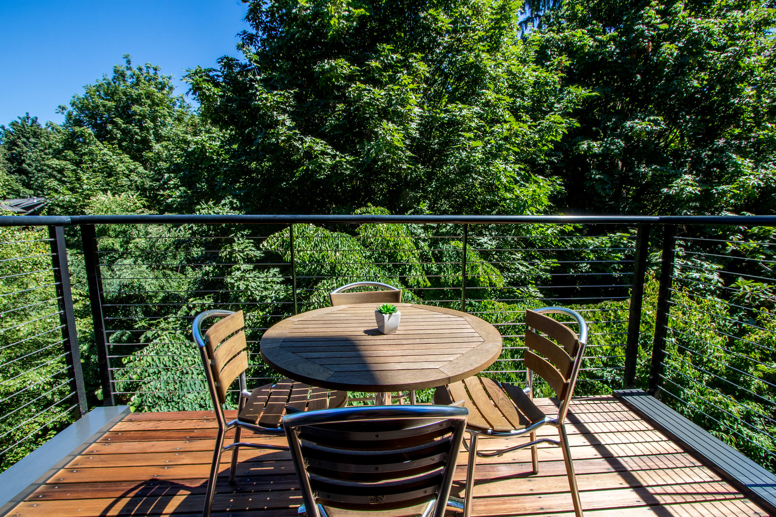 This deck off the living room is perfect for your morning coffee. You'll feel like you're on vacation every day with the rich, lush landscaping!