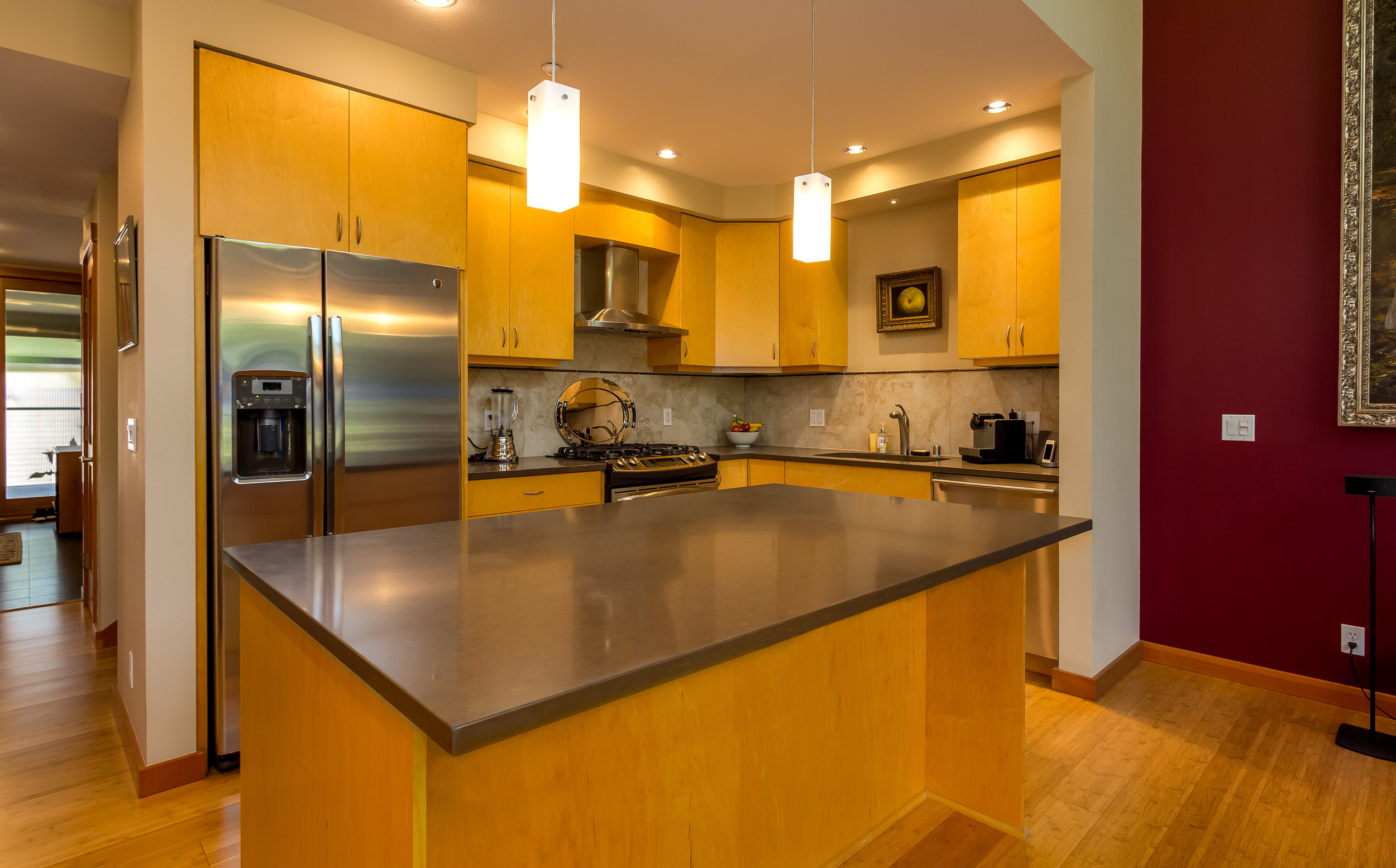 Spacious and bright, this kitchen has a large island for food prep, Quartz countertops, stainless appliances, a new refrigerator and more!