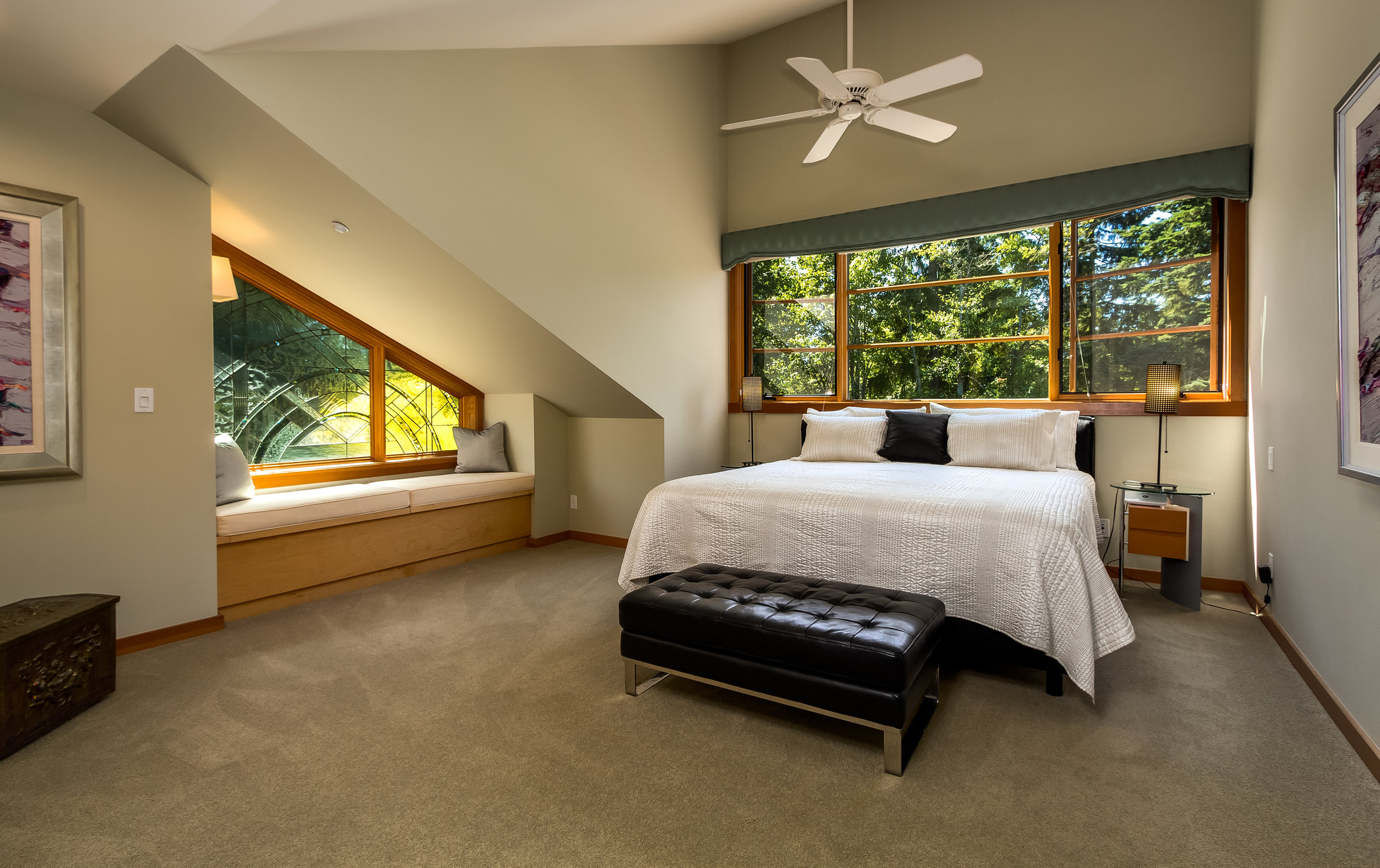Master Bedroom on second floor is huge! Vaulted ceilings, window bench complimented with Artisan leaded glass, ceiling fan and walk in closet all add to the space.