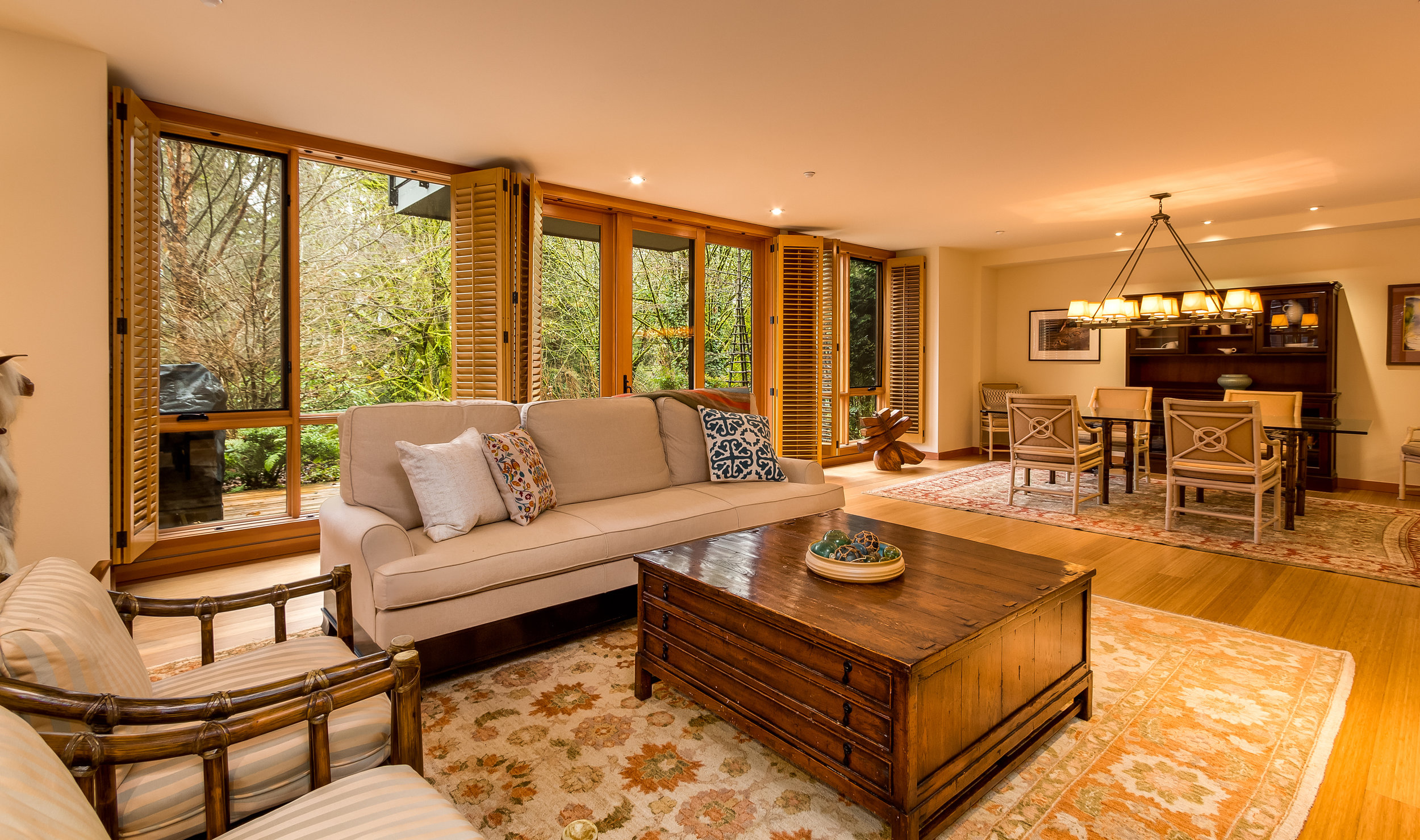 This shot of the living room shows the windows with their custom designed wood plantation shutters.