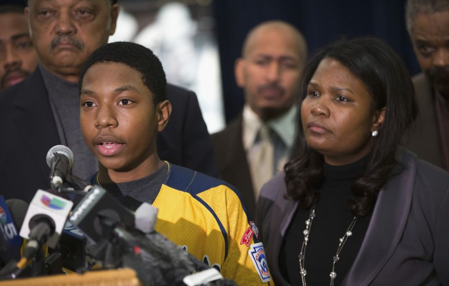 Photo: Scott Olson / Getty Images     Brandon Green, a player for the Jackie Robinson West Little League baseball team, speaks alongside his mother, Venisa.
