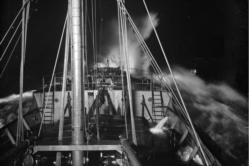 The bow of SS Eston in rough seas at night