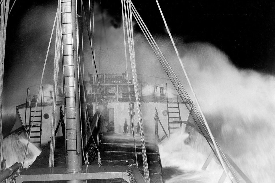 SS Eston with bow in heavy seas at night