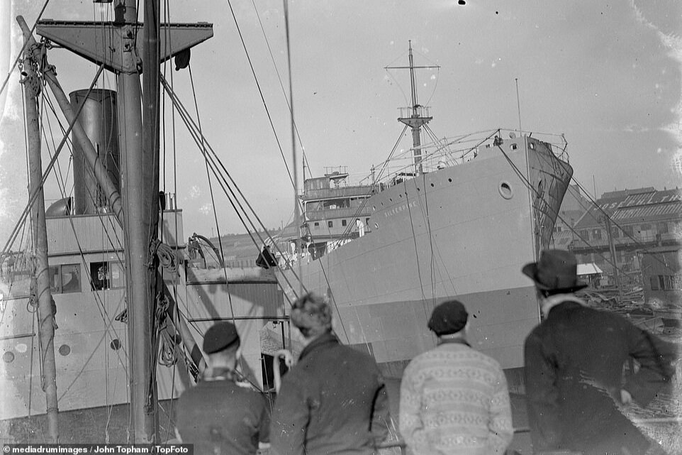 Crew watching other ships from SS Eston