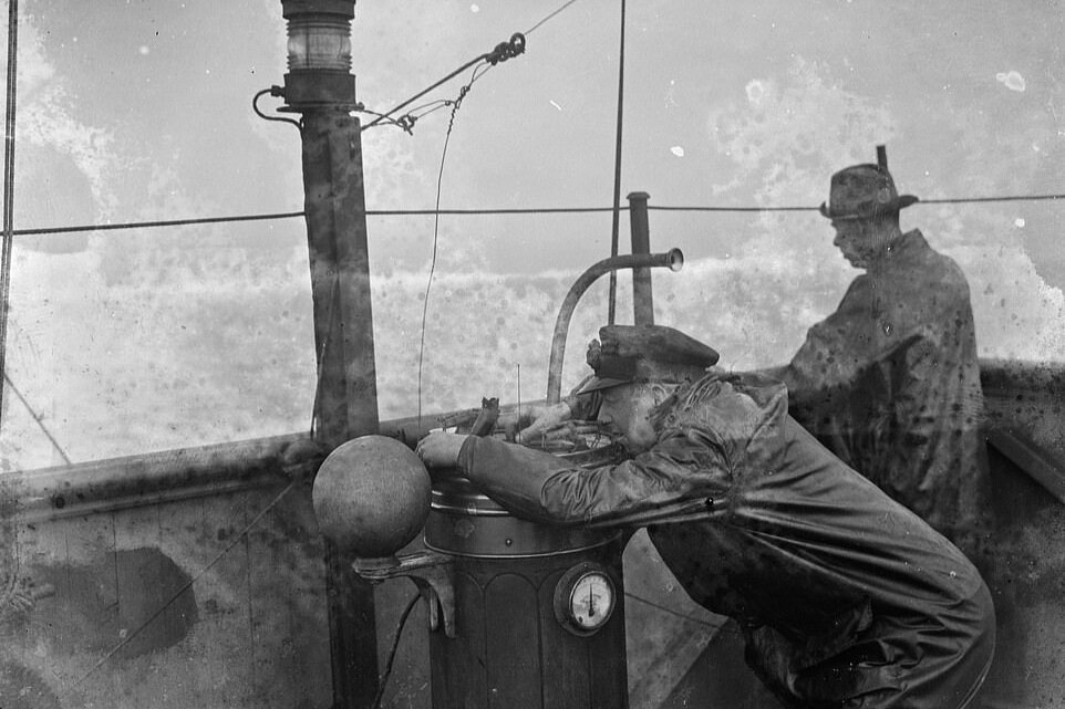 Captain of SS Eston fixing position using ships compass