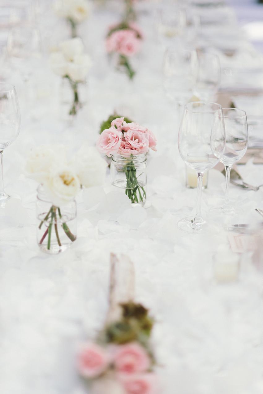 persia-white-joseph-morgan-wedding-goldeneye-hotel-oracabessa-jamaica-ocho-rios-details-centerpieces-roses-driftwood-sara-megan-photography