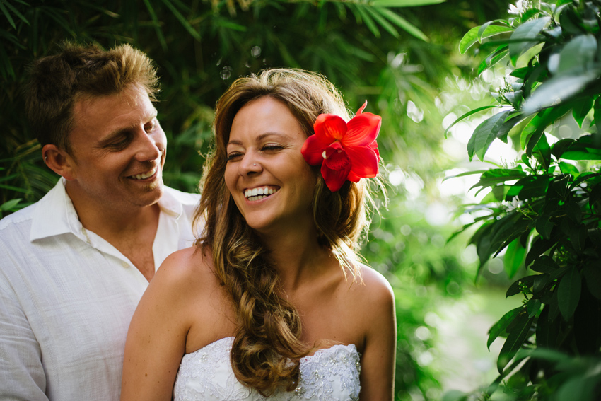 Bride & Groom Laughing in Montego Bay, Jamaica with Flower Headpiece