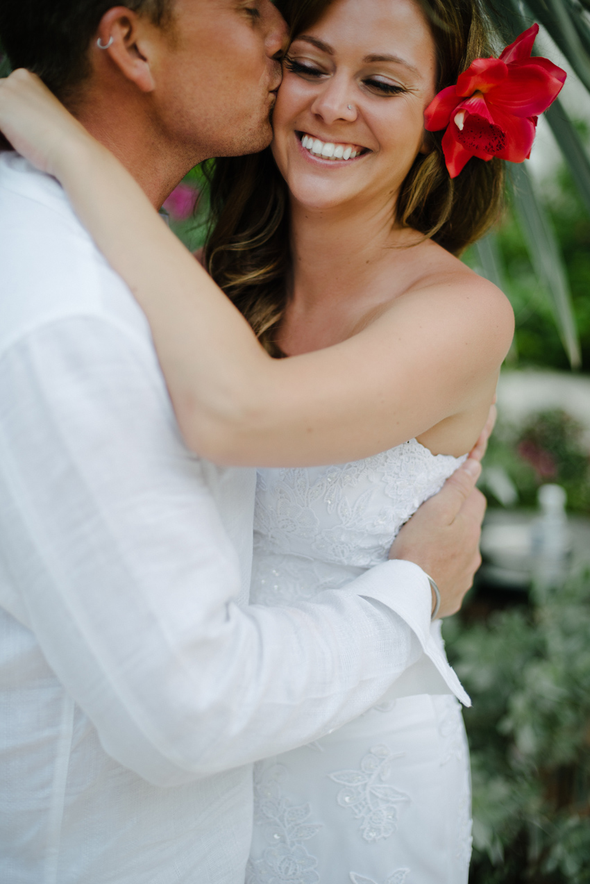 Groom Kissing Bride in Montego Bay, Jamaica in Tropical Day-After Shoot