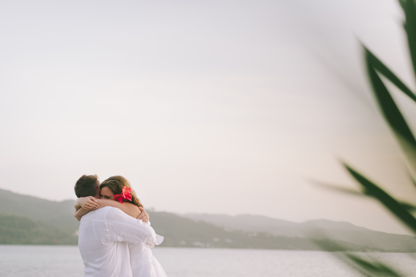 Wedding Couple embracing at sunset in Montego Bay, Jamaica by Jamaica Wedding Photographer