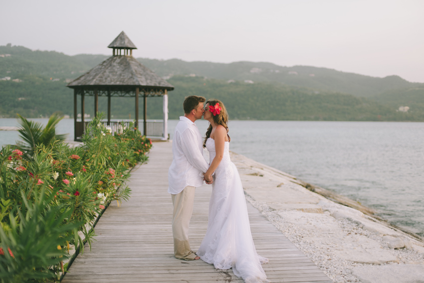Bride & Groom Kissing by Gazebo by the Sea at Secrets Wild Orchid in Montego Bay, Jamaica by Jamaica Wedding Photographer