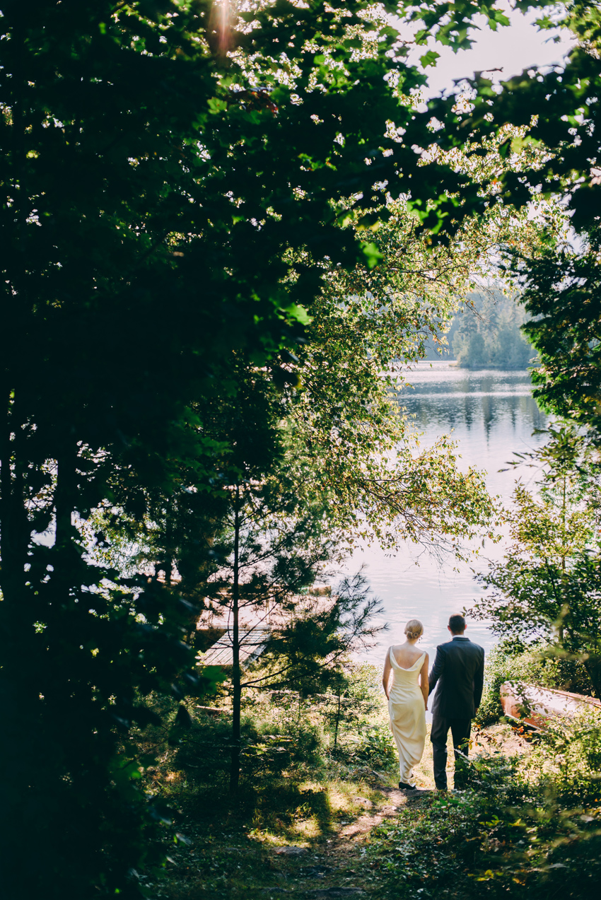 Bride & Groom walking down to the lake by Esterel Wedding Photographer