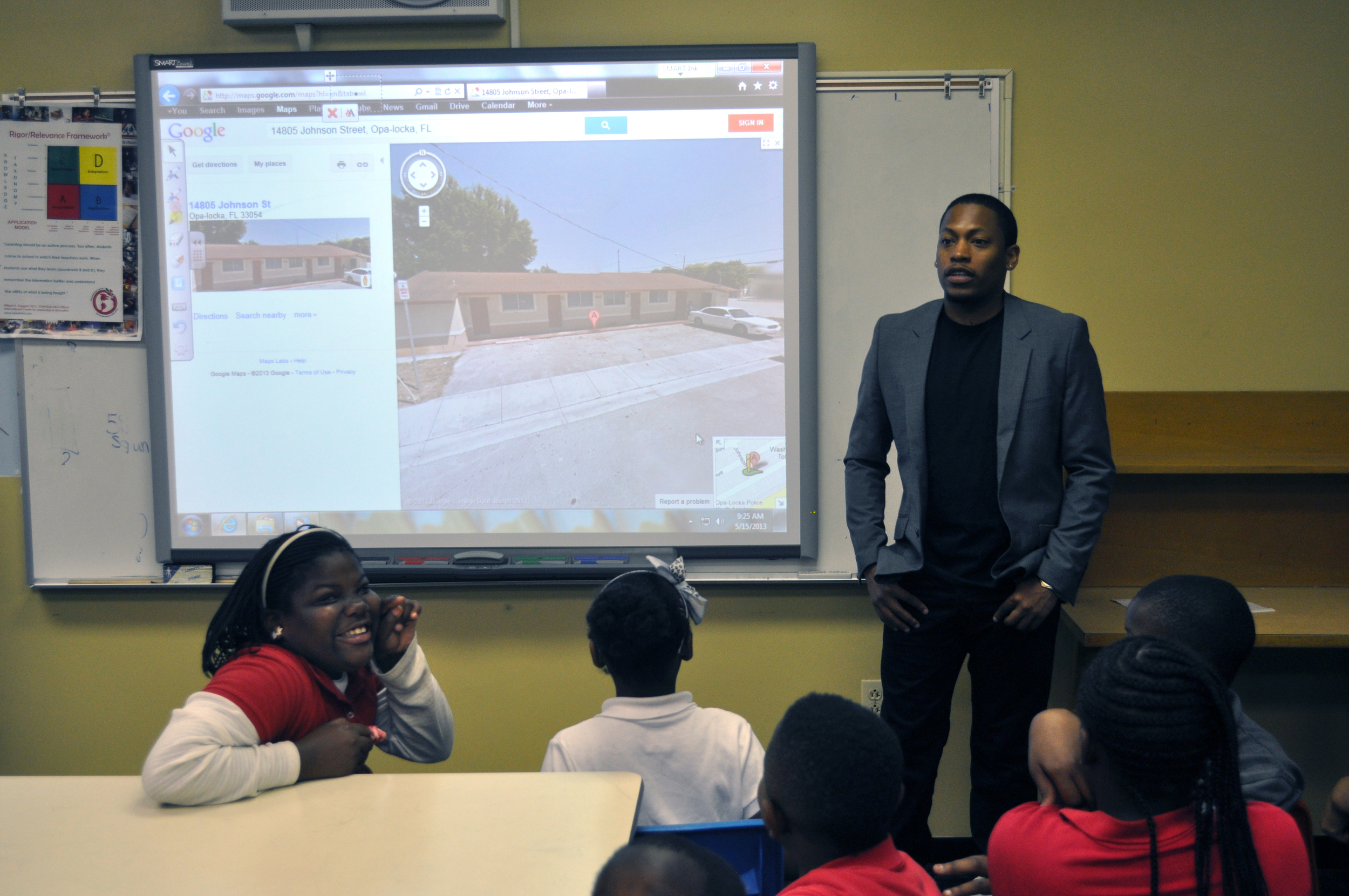 Germane shows students where the first Public House will be located in Magnolia North with Google Maps.