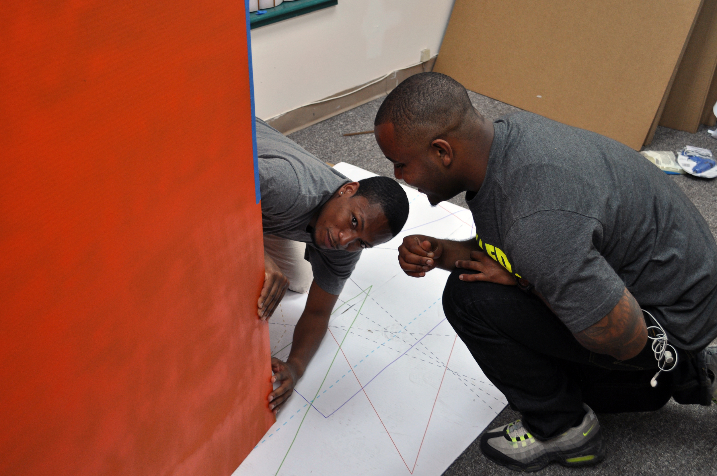 Germane and Chris assemble the first cardboard structure.