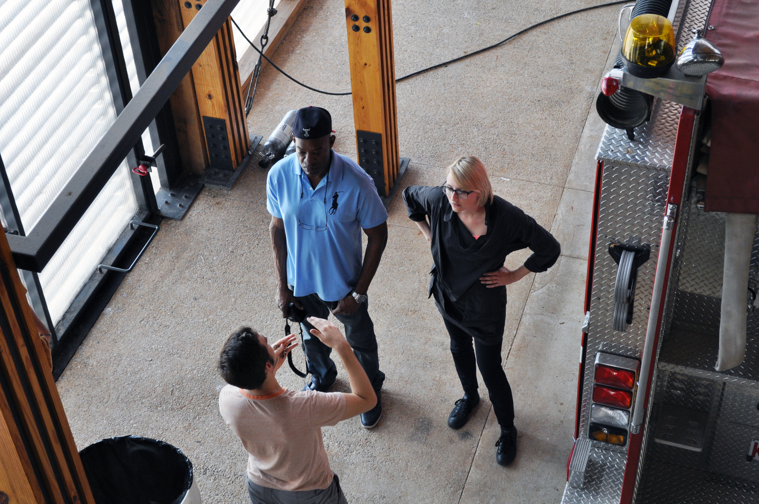 Dr. Willie Logan and Jennifer tour the Newbern Volunteer Fire Station with a Rural Studio student.