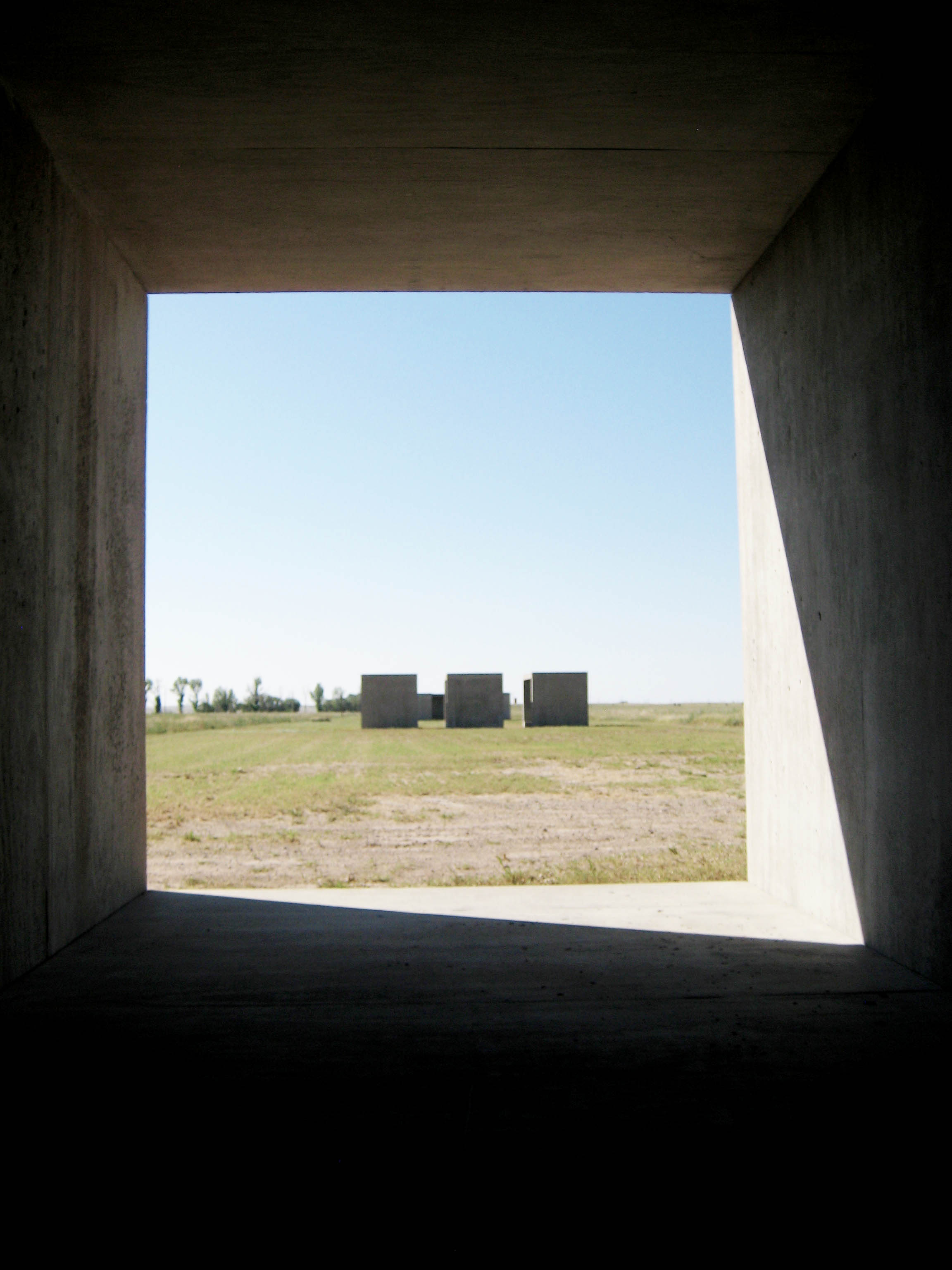 View from inside one of Donald Judd's works in Concrete.  Placed along the North South Axis of the Chinati Foundation, the forms play with the light from the sun.