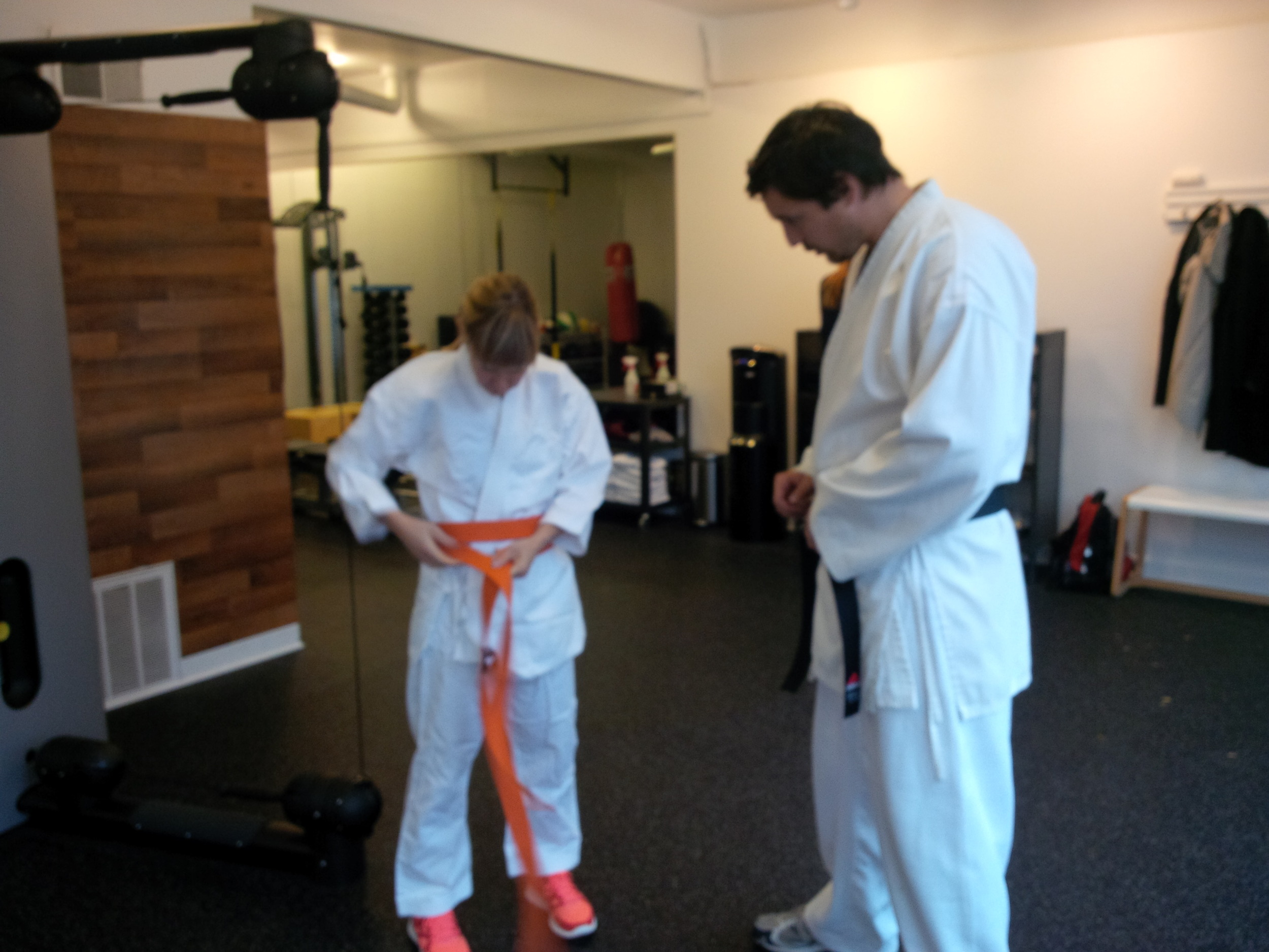 Me and my Sensei Predrag:  the very important belt-tying ritual.  (He is very large.)