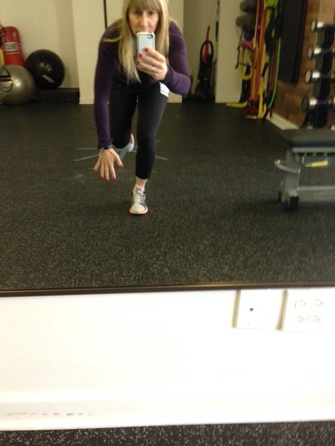 Single Leg Squat. Reach one arm to the floor.
