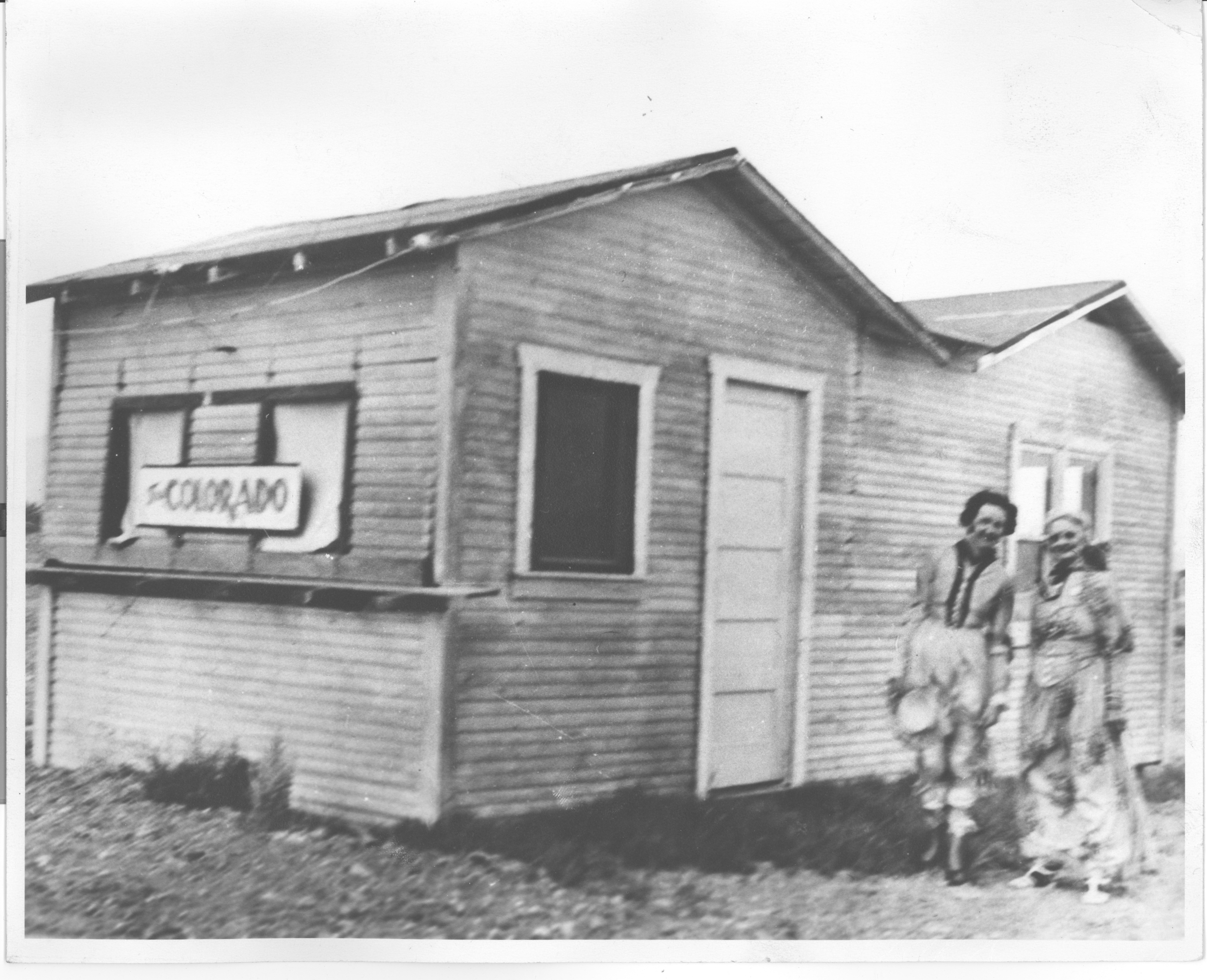 """""""Jimmie"""" Jones and friend outside the Colorado Restaurant before it became the Green Shack."""