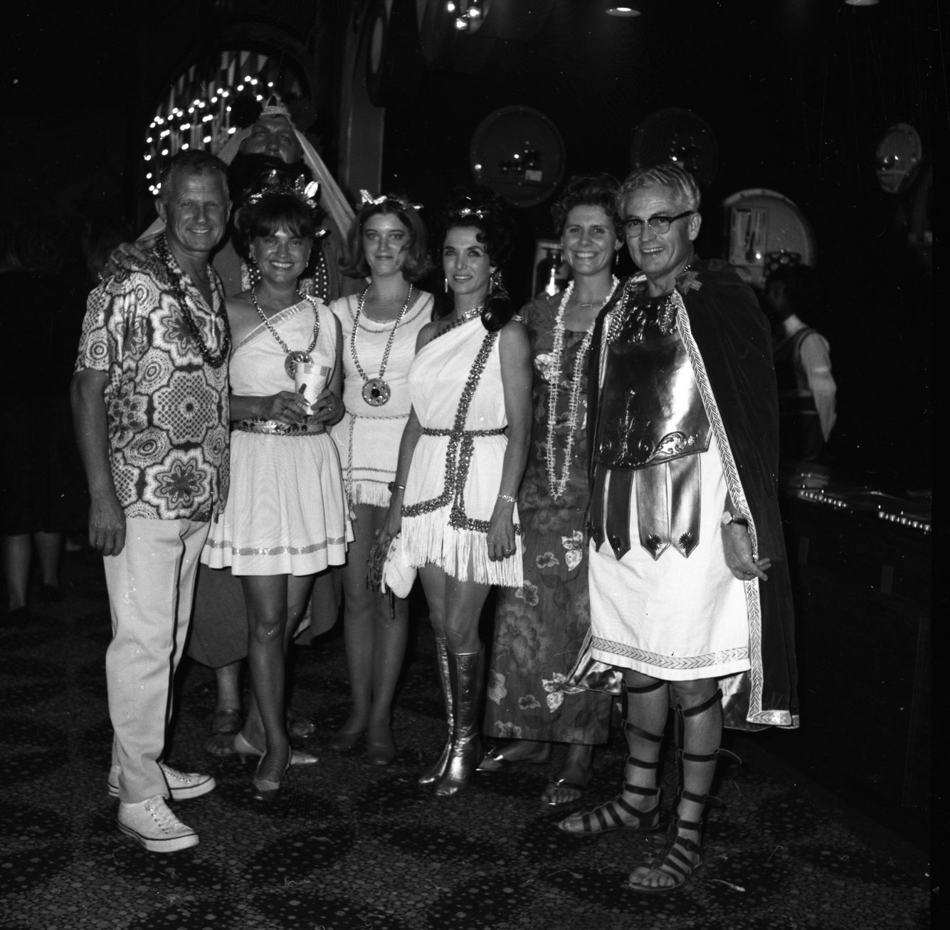 Tourists hang out with the staff at Caesars Palace