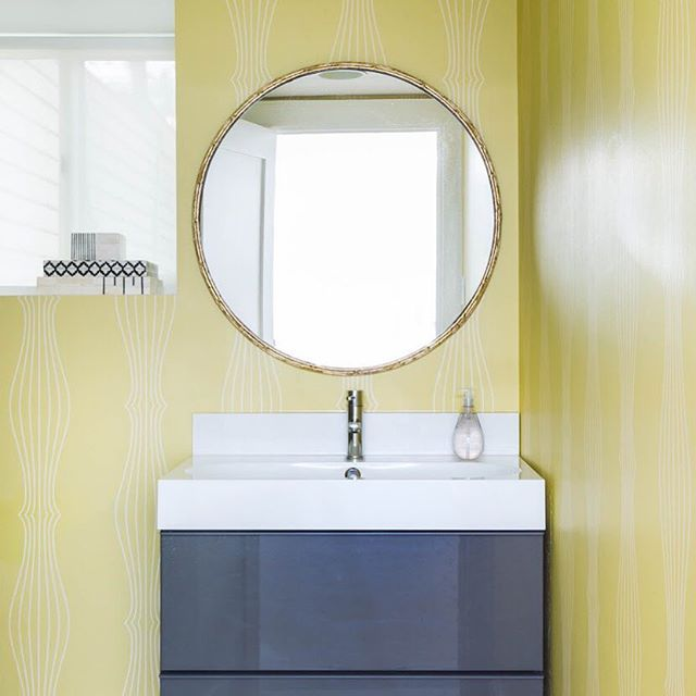 BRING SOME SUNSHINE IN // Its finally warming up and the the clocks are changing tonight to bring us more sunshine! We brought some sunny cheer to this basement bathroom years ago with an acid yellow wallpaper from @osborneandlittle and we love how much punch it packs. #designincolour #bathroomdesign #basementdesign #meghancarterdesign 📸 by @stephanibuchmanphoto