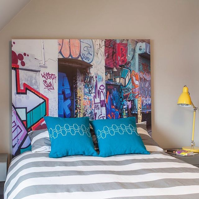 BE AN ORIGINAL // We are in the early planning stages of a large project with a family with 4 kids. So we've been brainstorming ways to make each kids' space unique to them. This is a headboard that we designed about 5 years ago for a client's teenage son. He was really into graffiti at the time so we asked @leslie_goodwin_photo to go down to Graffiti Alley in Toronto to take a bunch of shots. We picked this one and had it made into a headboard for him. Coolest thing about it? It doubled as an original work of art for him to take when he moved out. How cool would this be hanging in the living room of a 20-somethings first apartment? #artisimportant #designoutsidethelines #beoriginal #kidsdesign #meghancarterdesign 📸 by @leslie_goodwin_photo