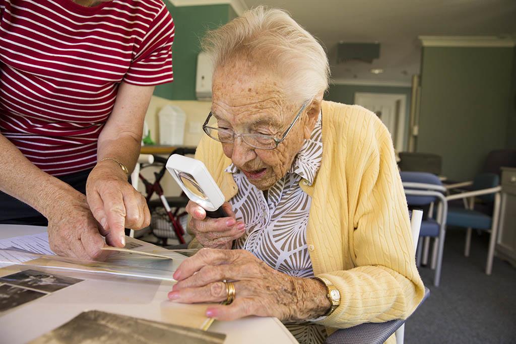 Jene Baker looking at her photographs.