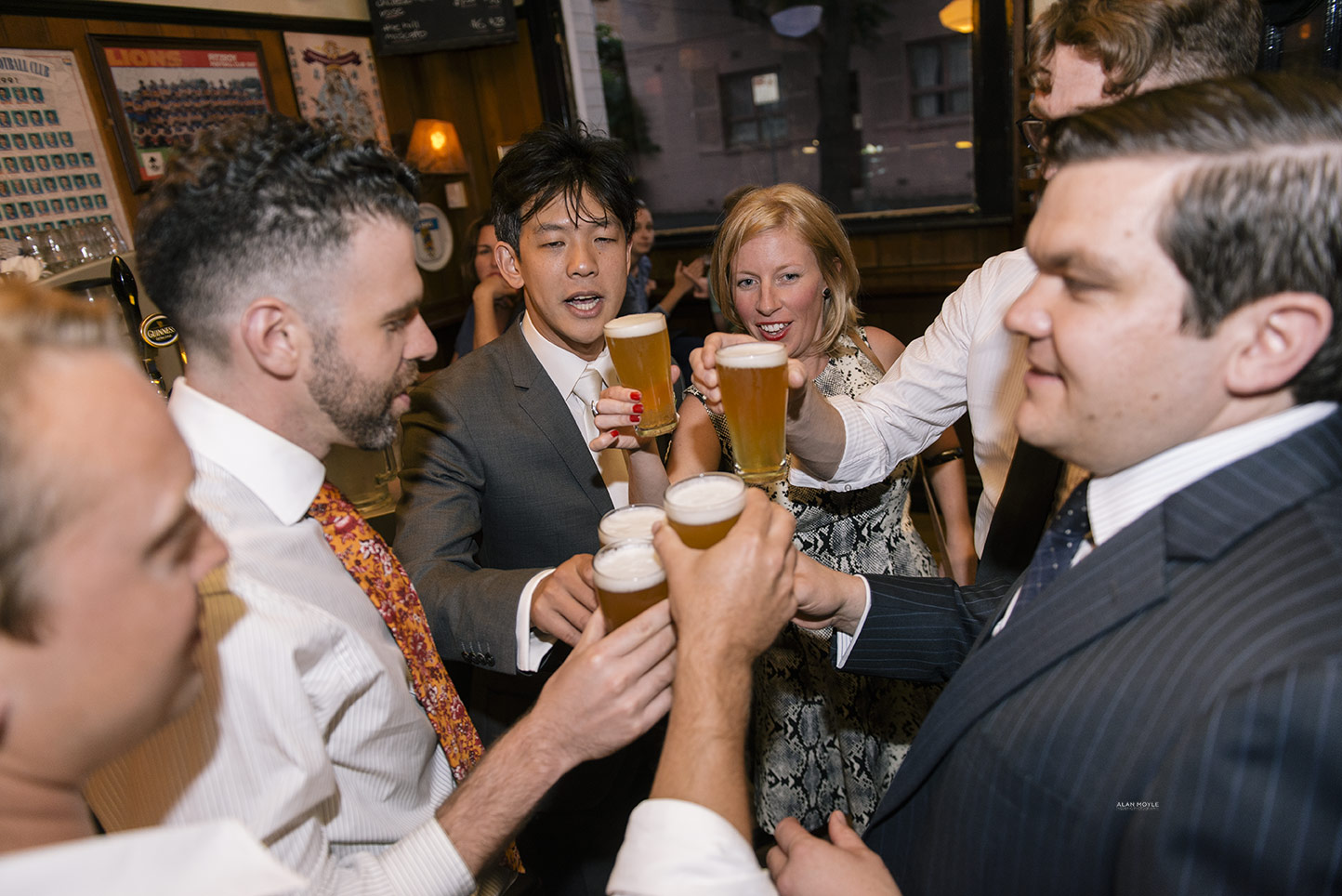 1401wu-552fitzroy_town_hall_wedding_napier_hotel_groom_sneeky_beer_photobat_alan_moyle.jpg
