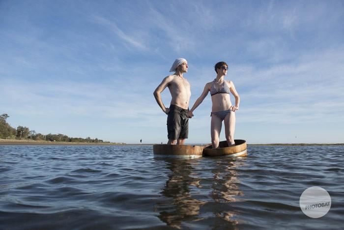 1311cassidy039_melbourne_brighton_sandringham_engagement_portrait_beach_fun_beaumaris_blackrock_wine_barrels_photography_fun_water_wet_couple_barrels.jpg