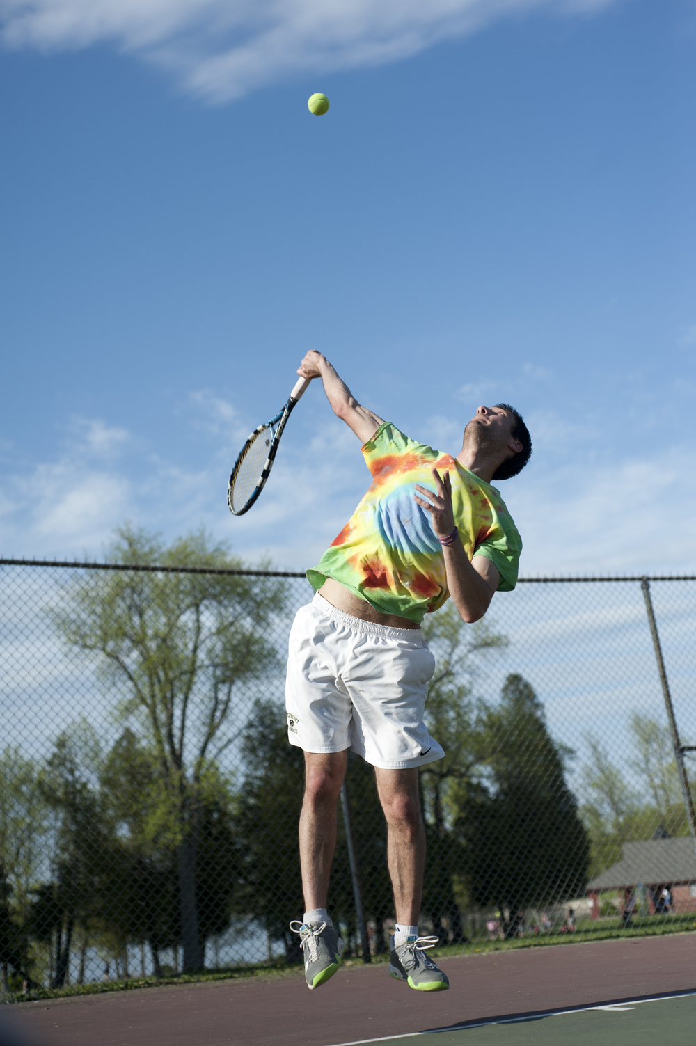 Alumnus Caleb Fields serves the ball at Oakledge Park May 21, 2014. Fields was a member of the club tennis team at UVM while in college.