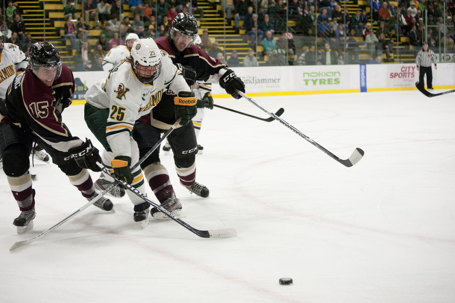 Sophomore Nick Luukko reaches to get the puck past Concordia defenders in an exhibition game Oct. 6, 2012.