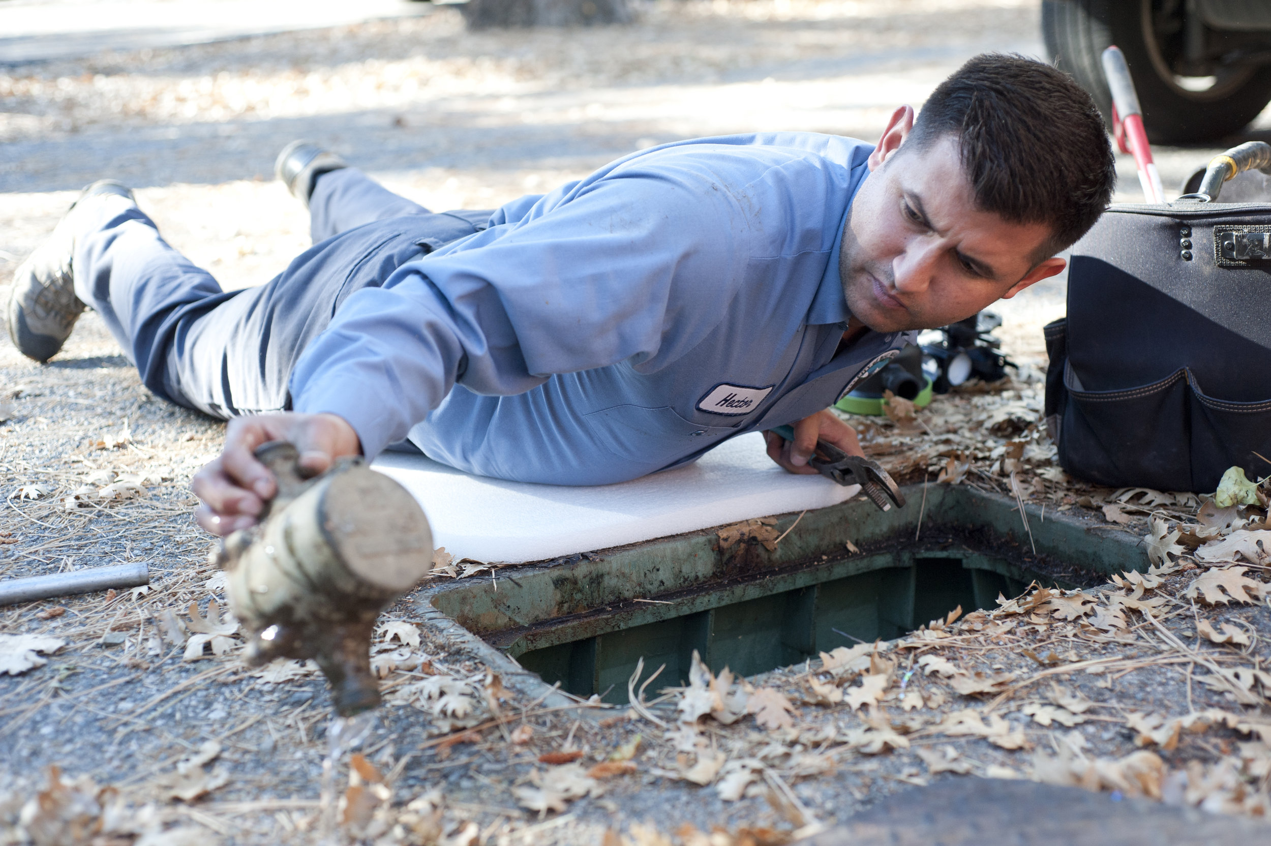 Hector Pedroza, meter technician for the Big Bear Lake DWP, removes the old meter from a residence in Sugarloaf Nov. 3, 2016. The DWP hit the halfway point in the water meter replacement program in 2016.
