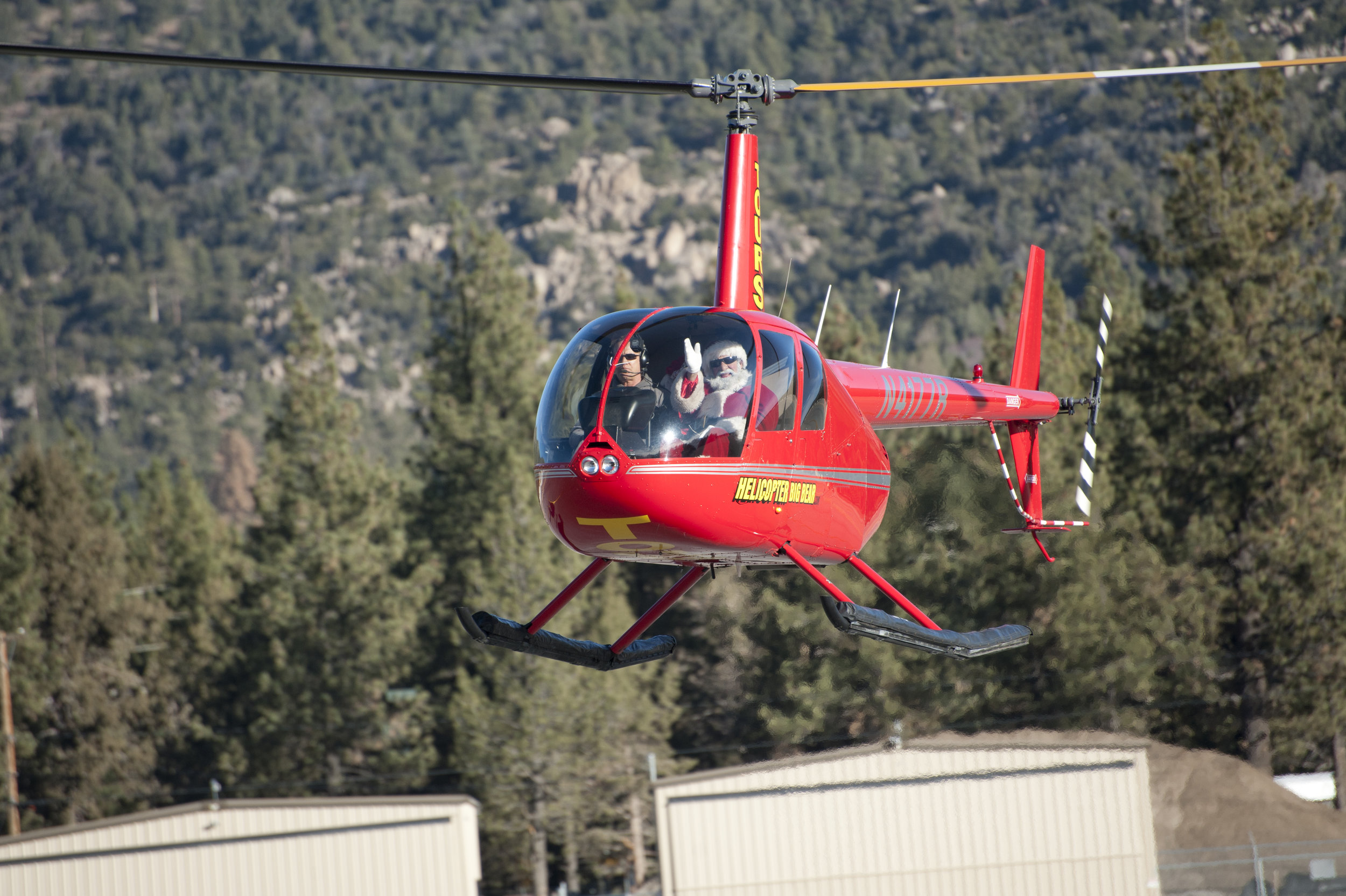 Santa descends toward the airport runway before Breakfast with Santa Nov. 26, 2016. In Big Bear, Santa doesn't come by sleigh, he gets a ride in a helicopter.