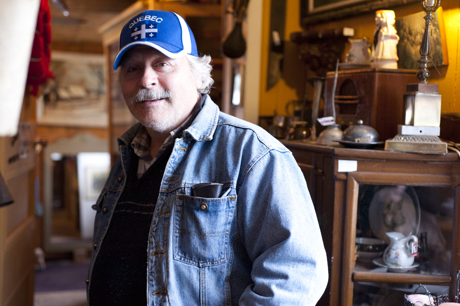 Shop owner Bernard Benoit discusses his antique shop, Chez Mon Oncle, in Sabrevois, Quebec, May 22, 2014. He has owned his shop, which features everything from antique tea pots to a taxidermic dear head, for 26 years.