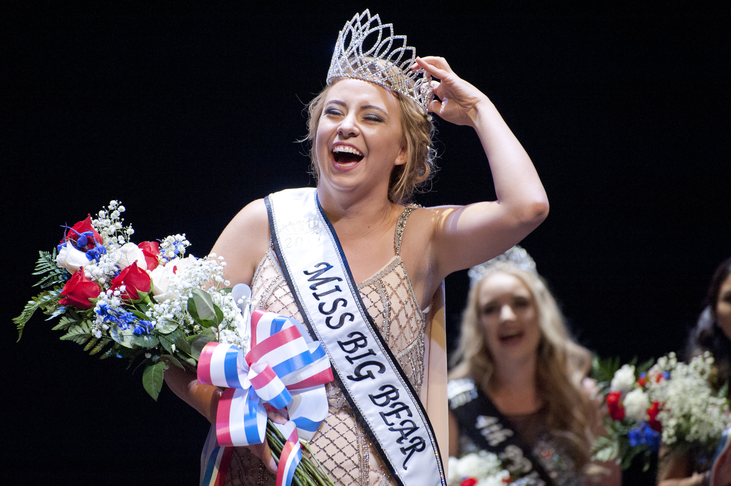 Charlotte Haston straightens her crown moments after winning the Miss Big Bear pageant at the Big Bear Lake Performing Arts Center Sept. 10, 2016.