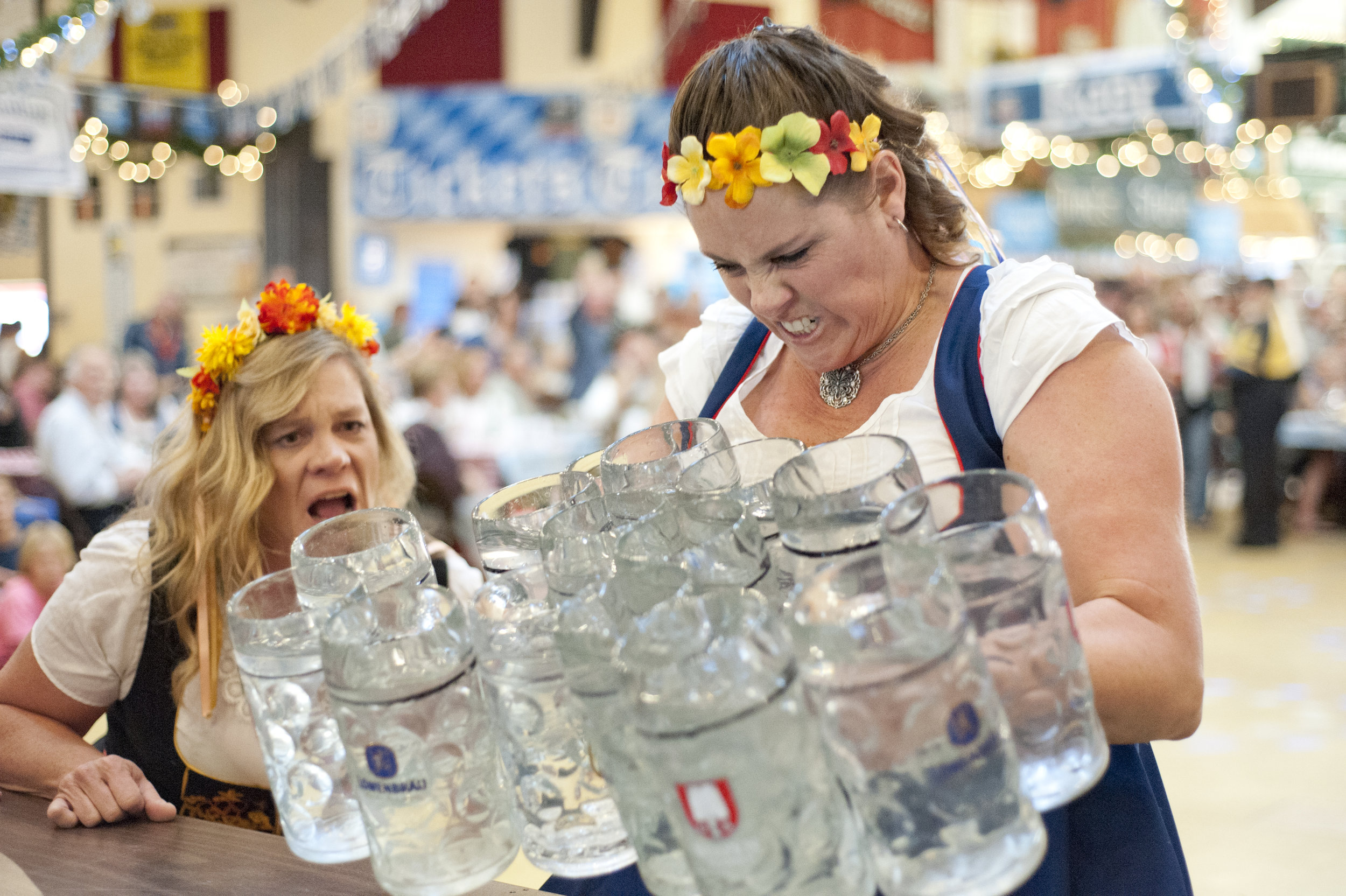 Melissa Tangeman, right, struggles to pick up the 15 water-filled steins during the finals of the Queen Stein Carrying Contest at Big Bear Lake Oktoberfest Oct. 8, 2016. Tangeman was second runner-up in the competition.