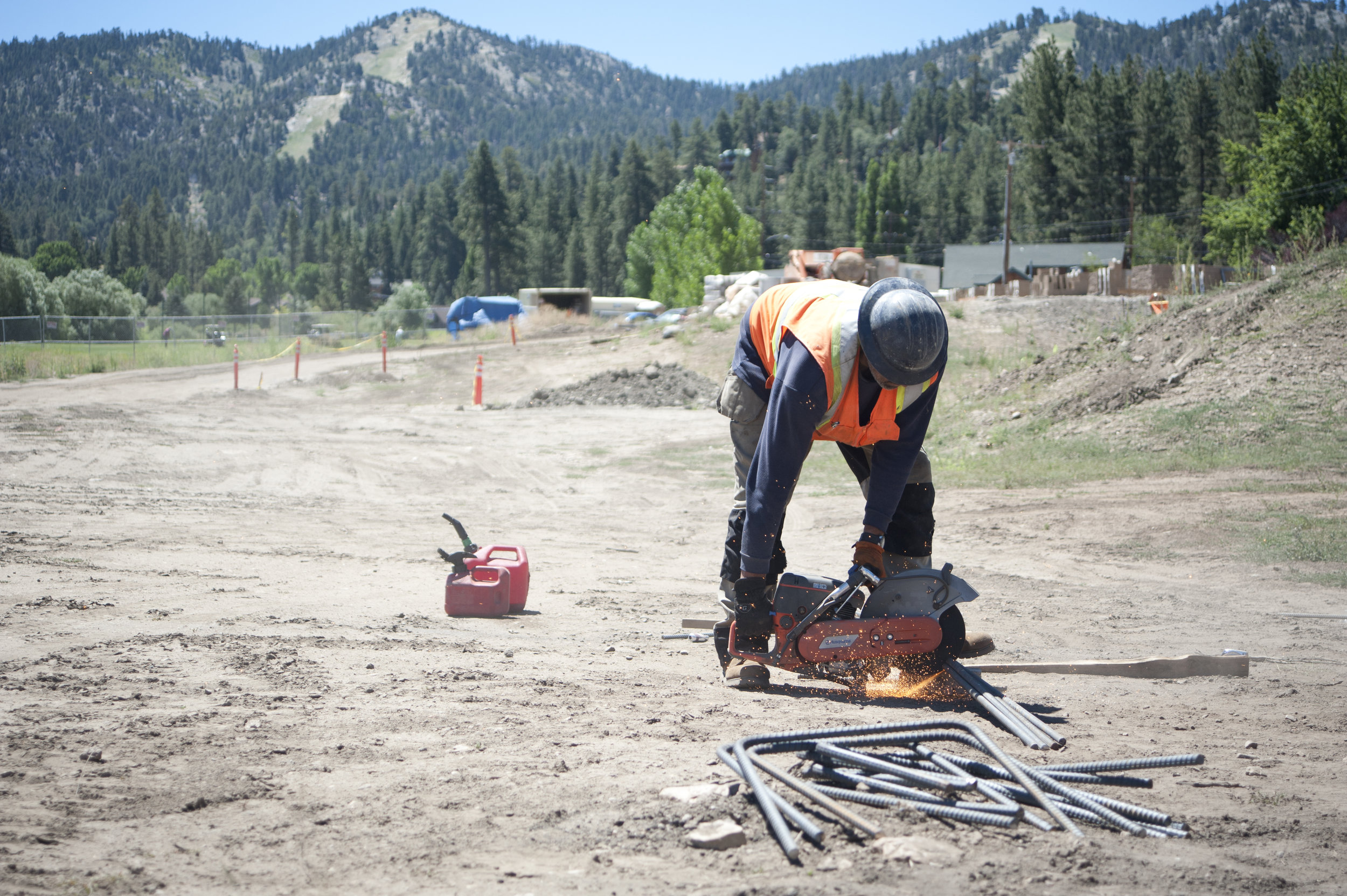 Sparks fly as Carlos Escalante cuts metal rods for the carnivore enclosure at the site of the new Big Bear Alpine Zoo July 21, 2017.