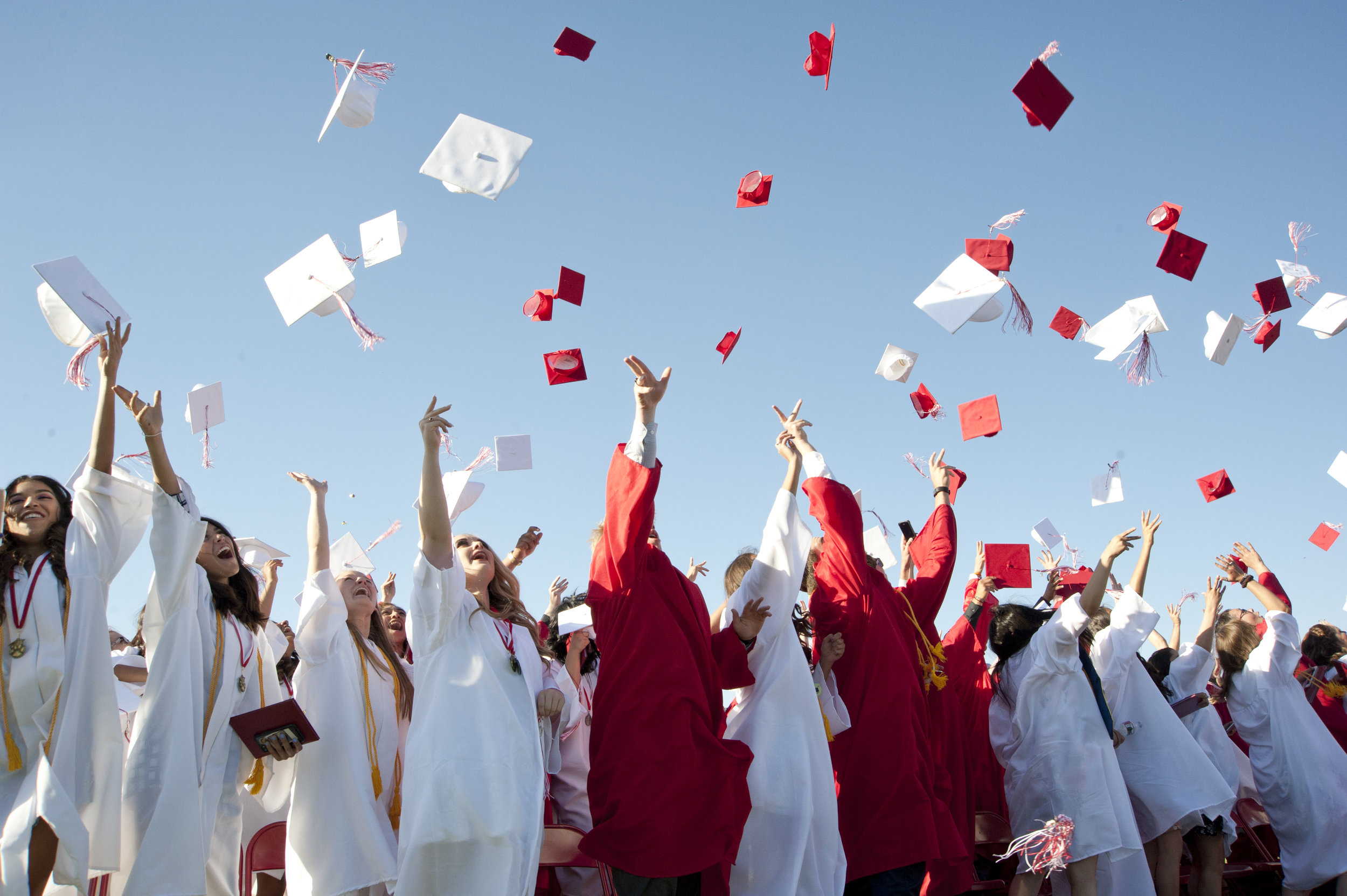 Members of the class of 2017 take the first step toward their adult lives as they toss their caps in the air June 16, 2017.