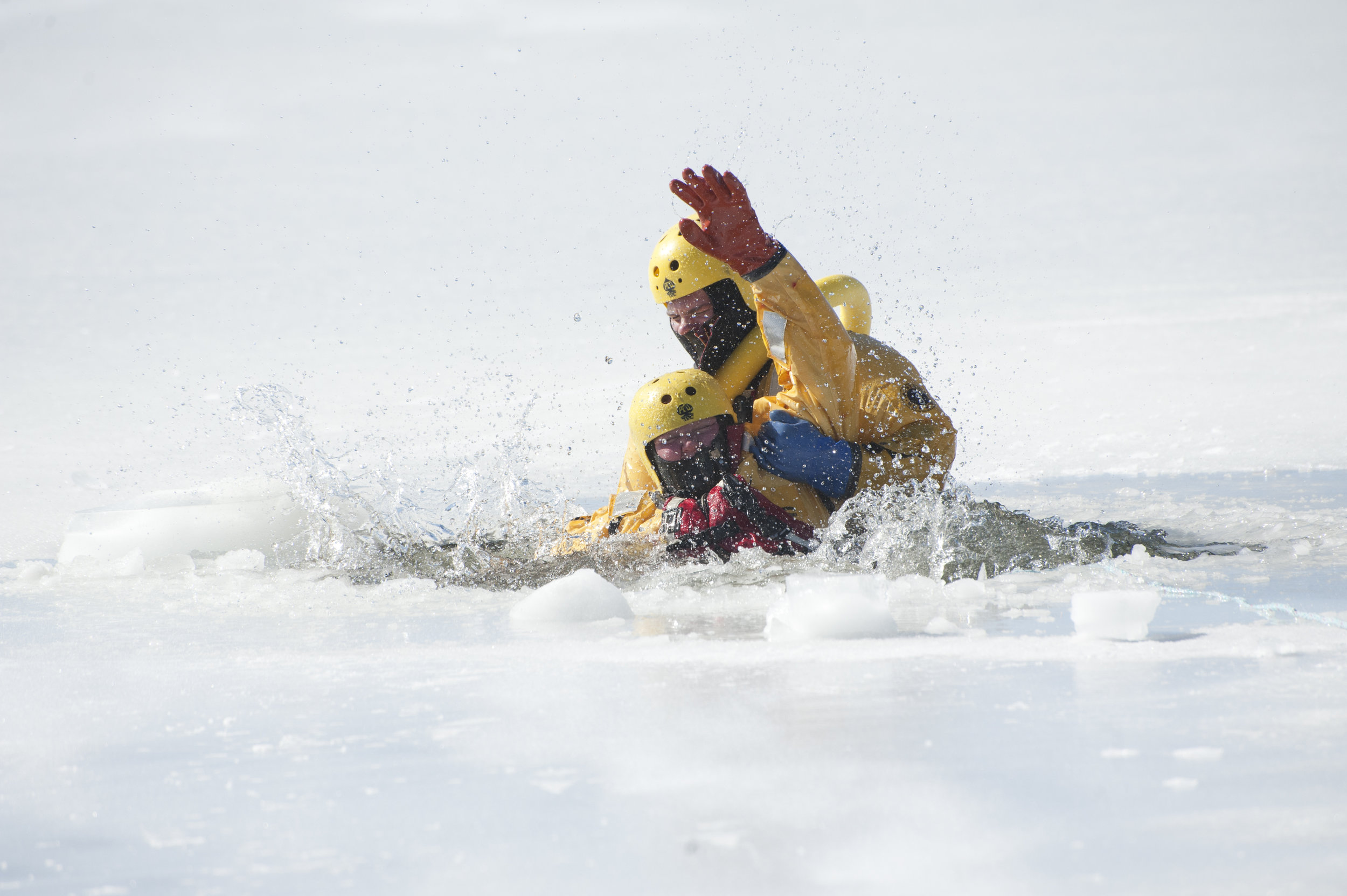 Firefighter Brittania Huether, front, struggles as a victim would, as Jordan Willis rescues her from the water during ice rescue training Jan. 27, 2017.