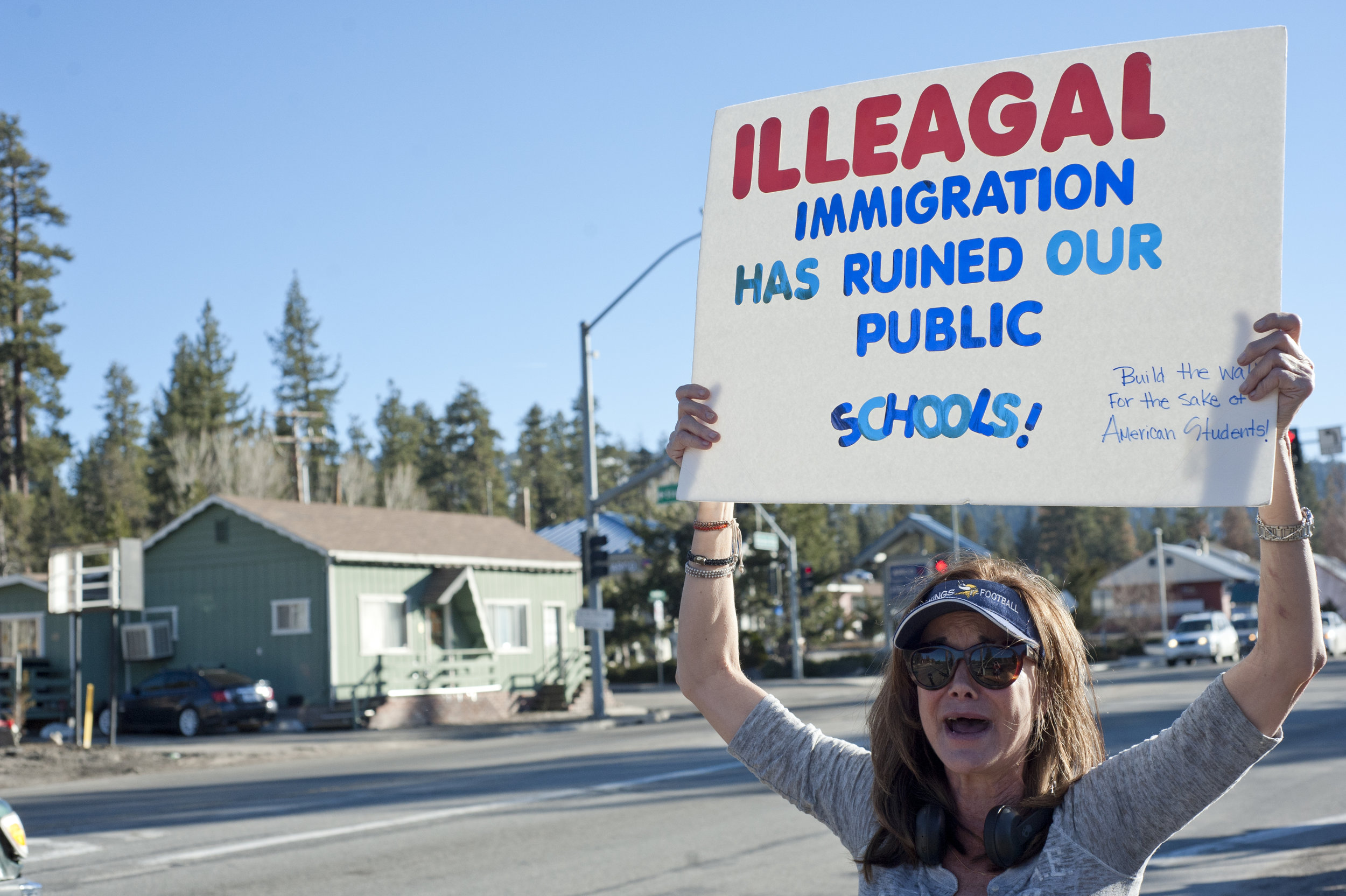 Retired teacher Adelle Manos expresses her concerns about illegal immigration as the only conservative protester the afternoon of March 8, 2017, in Big Bear Lake.