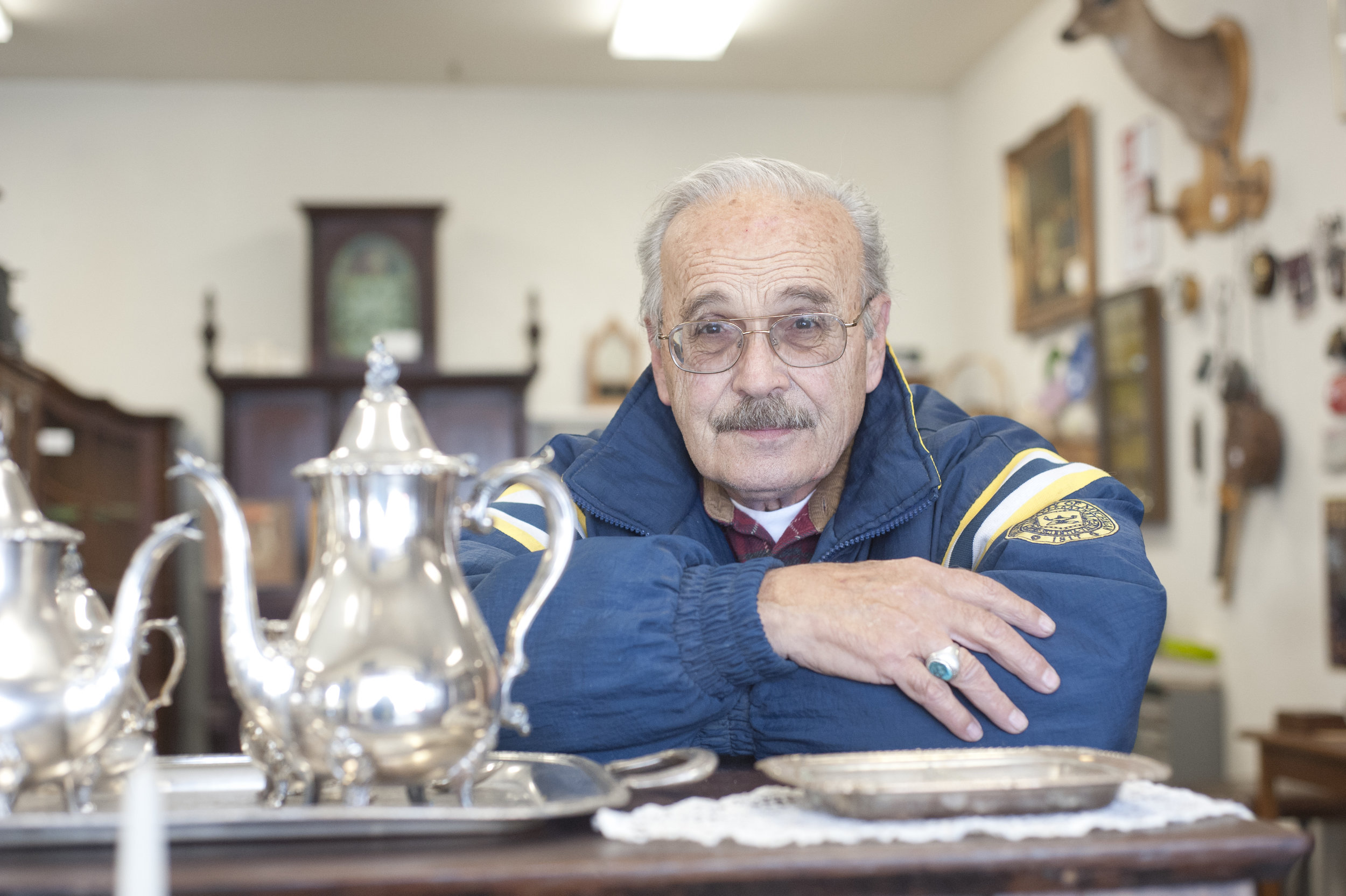 Sam Davidson, owner of Fox Farm Antique Mall, discusses his love for antiques, specifically wood pieces while sitting in his shop March 15, 2018. Davidson's business is 25 years old, and he credits the longtime success to the mall format that features a variety of vendors.