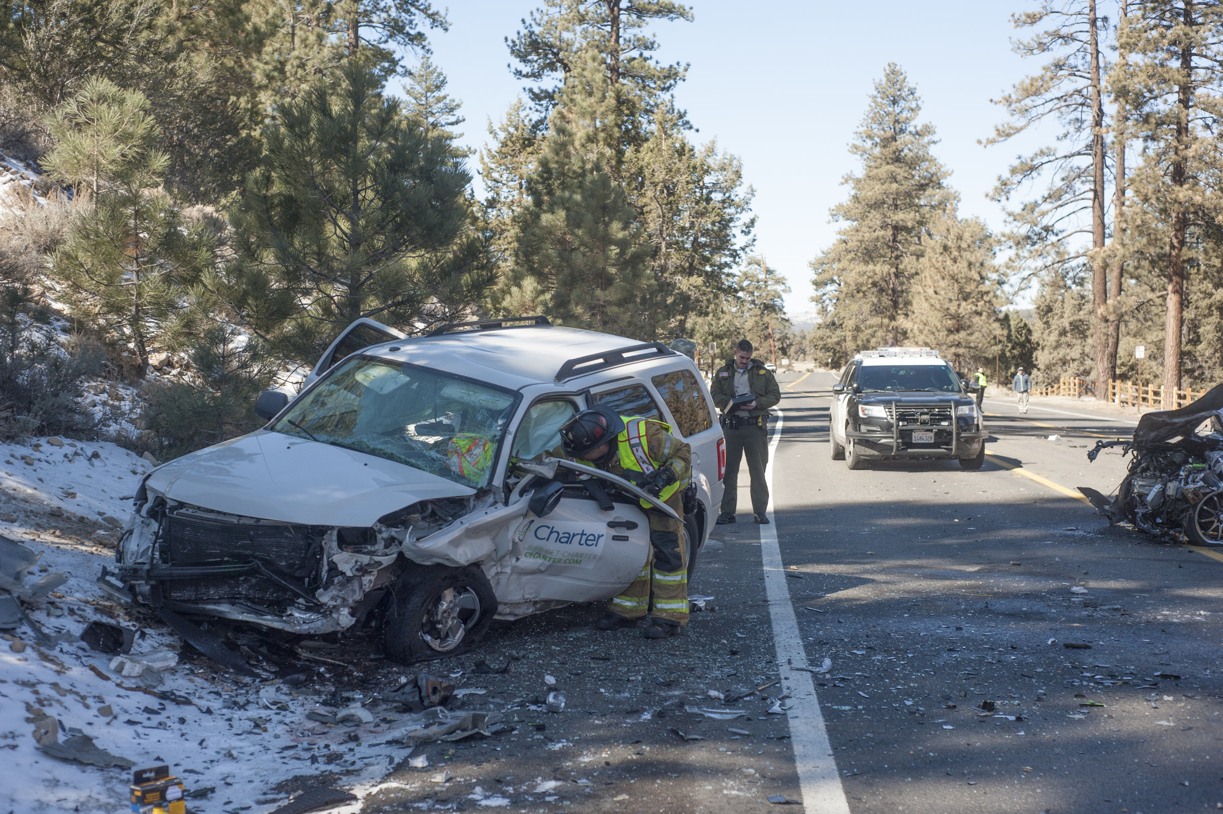 Big Bear Fire and Big Bear Sheriff's Station crews address a two-car collision that caused delays on Big Bear Boulevard near Division Drive March 5, 2018.