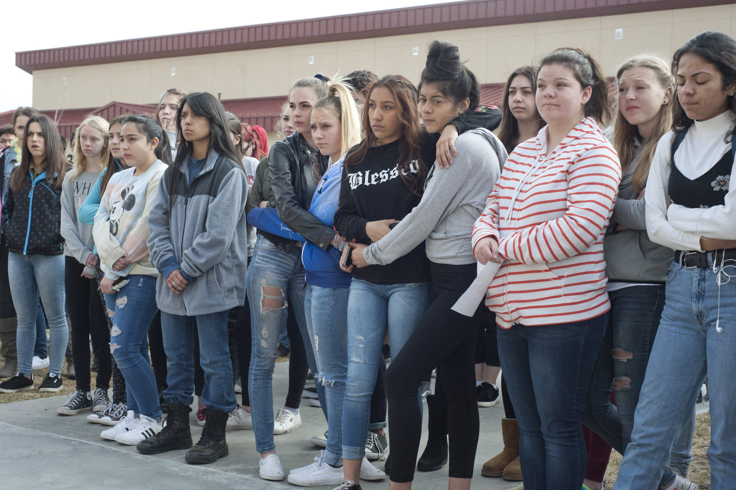 Students embrace while listening to their peers talk about the issue of gun violence at the Big Bear High School Walkout March 14, 2018.