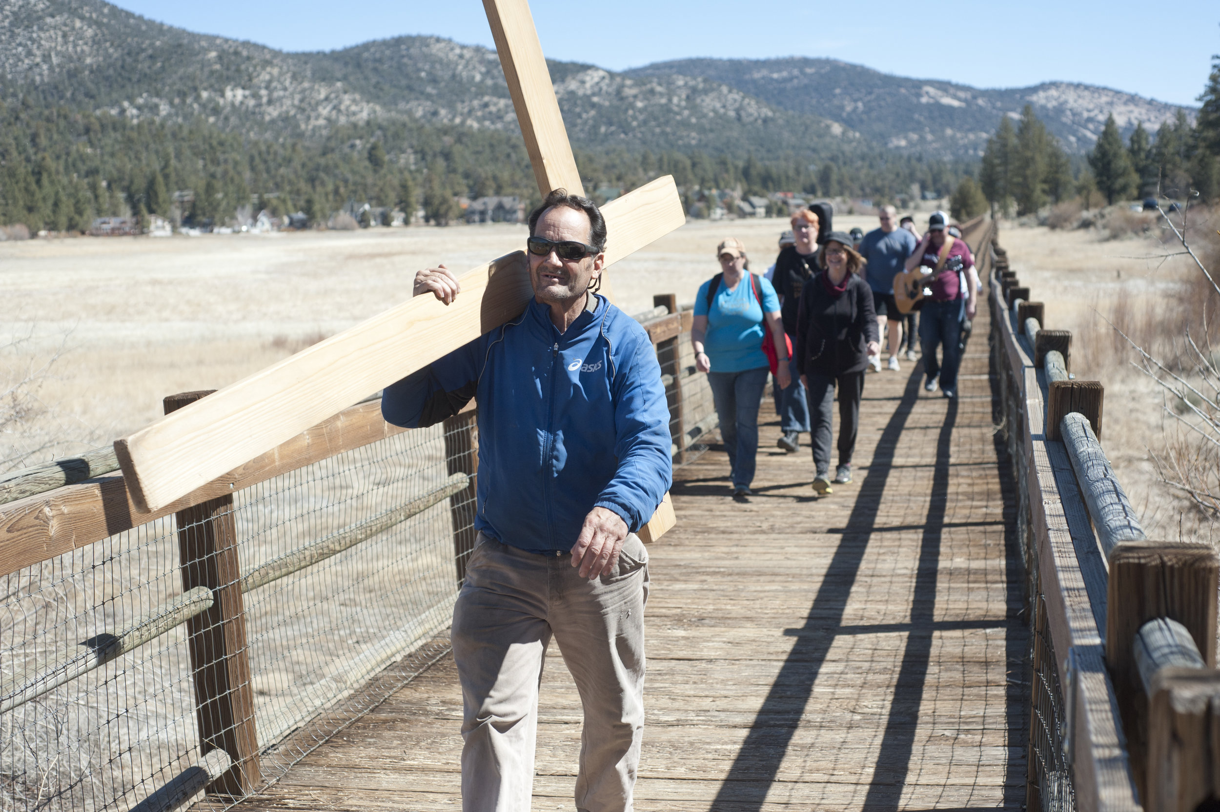 Jaymes Robillard, left, leads the way across Stanfield Marsh during the 11th annual Prayer Walk March 30, 2018.
