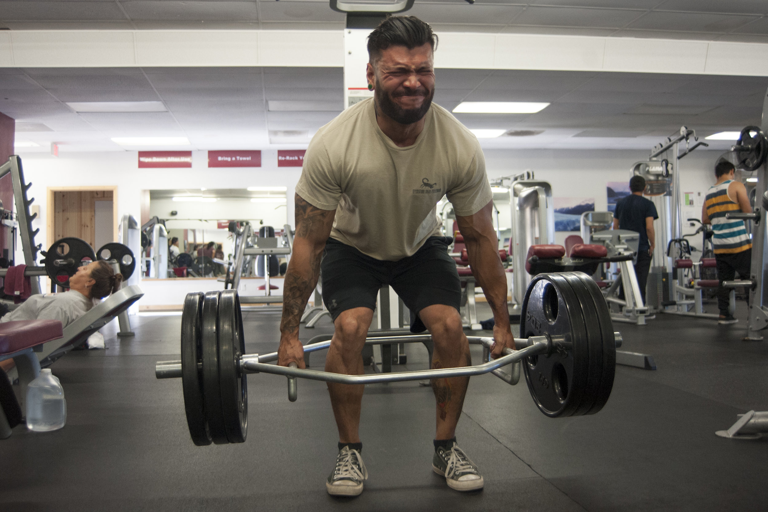 Personal trainer Dany Mena deadlifts three plates while working out at Wolf Total Fitness July 14, 2017.