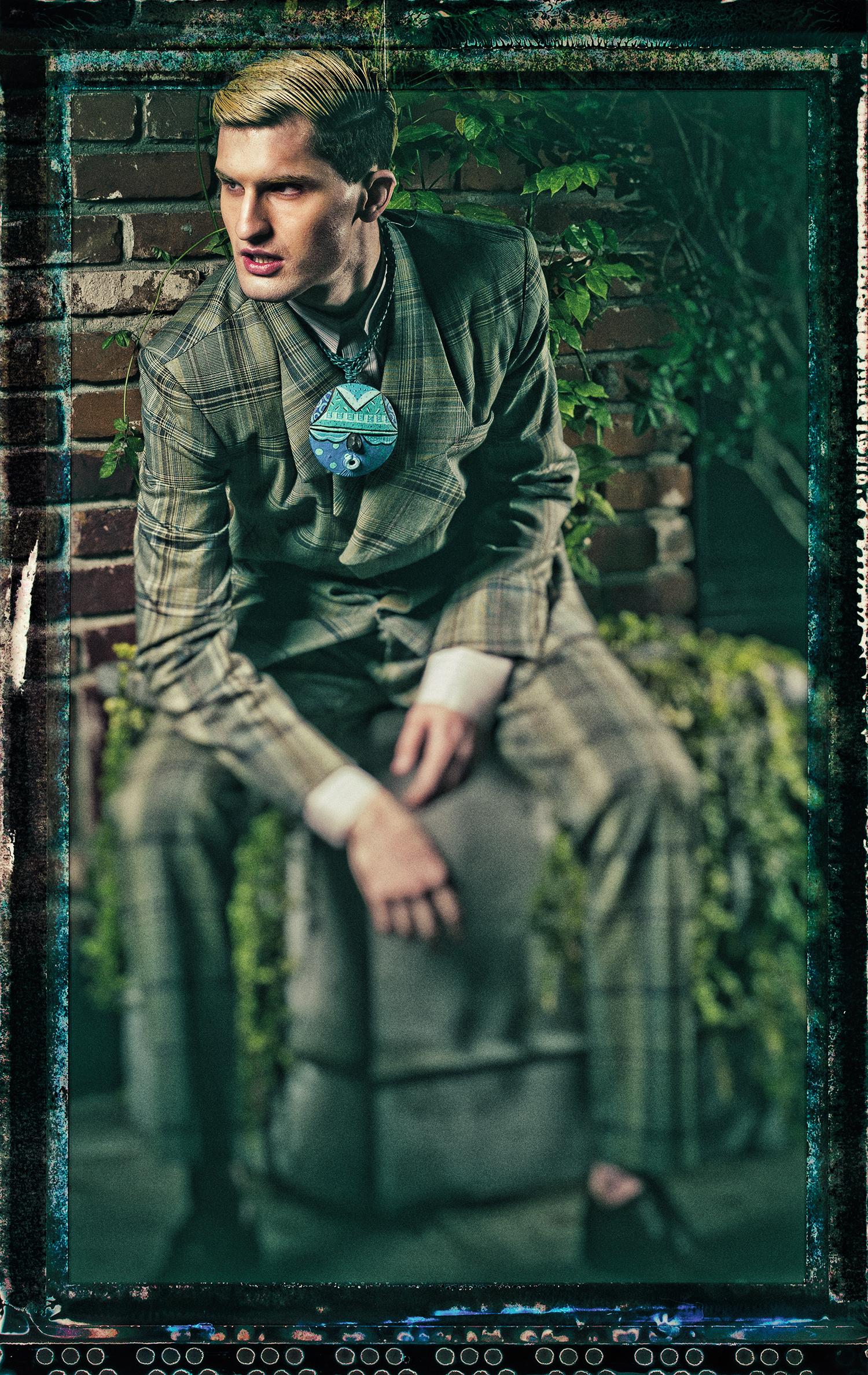 guy green suit sitting- topaz.jpg