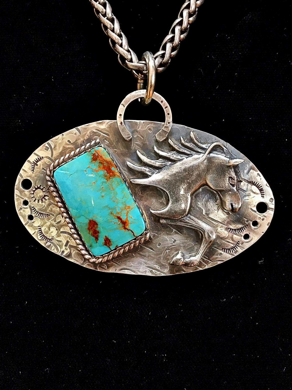 "- ""Head Winds"" features a Hubei Turquoise shaped by master stone cutter, Jason Brousseau, NM. Lots of great detail went into this piece – including the sterling silver horse. The pendant measures 2¼""h x 3"" w and hangs from an 18"" wheat weave chain. Worn wonderfully well with the addition of Navajo pearls."