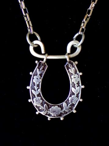 """- """"A Sense Of Peace"""" pendant in sterling silver - upright to catch all the good luck."""