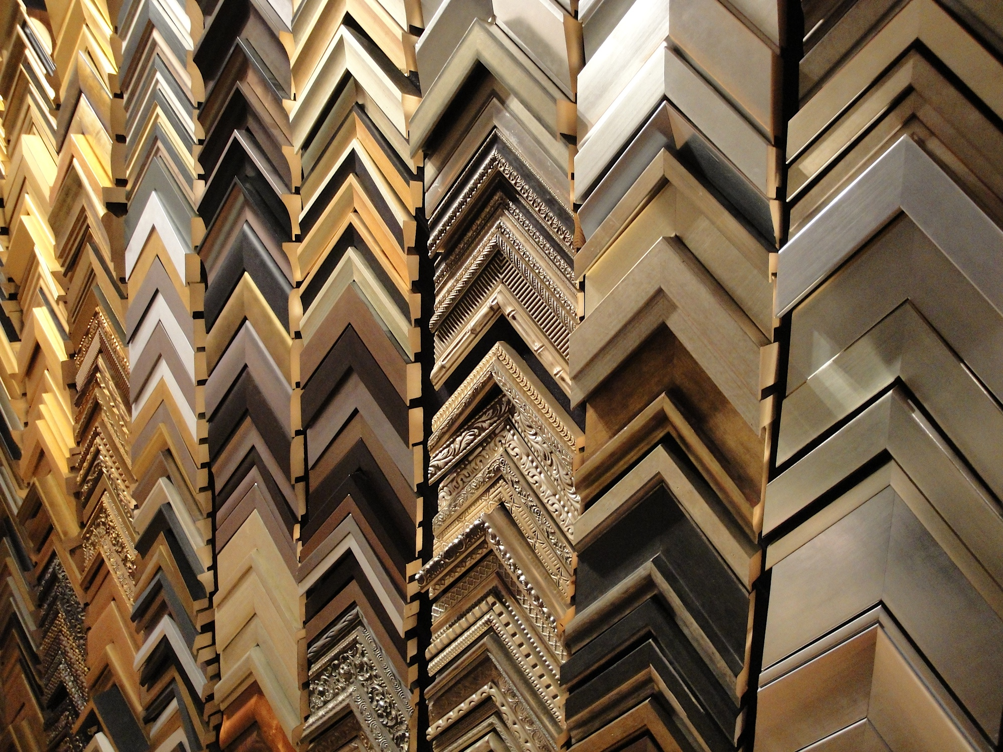 In addition to custom framing, we also provide a wide selection of ready made table top frames from Roma Moulding