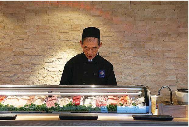 Sushi legend Shiro Kashiba at the bar of his hot, new sushi spot, Sushi Kashiba, in Pike Place Market