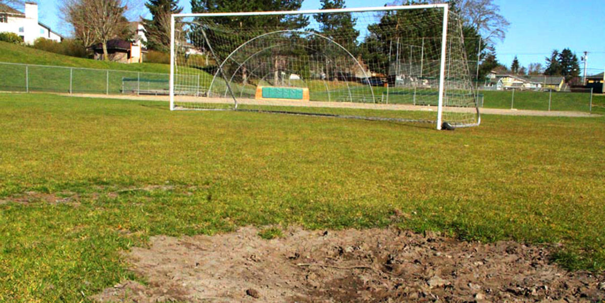 A patch of mud in the middle of 132nd Square Park's soccer field dries in the unseasonably warm weather of March 20. The city of Kirkland is planning to install a stormwater system beneath this field that will consolidate and treat stormwater run-off from the surrounding 48.5 acres. The project will require a 10-foot-deep hole that is nearly the size of the soccer field. Kirkland's leaders are seizing on this money-saving opportunity — as well as the need to expand park access — to replace the grass surface with synthetic turf. Photo courtesy of the city of Kirkland